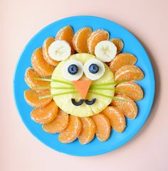 Lion Fruit Plate - oranges segments, pineapple slice, banana, blue berries, celery whiskers, carrot nose, olive mouth
