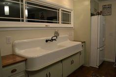 My sink.  :)  Vintage 1929 cast iron, double drainboard farmhouse sink.