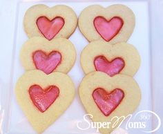 Stained Glass Sweetheart Cookies - Show your loved ones your heart with this deliciously simple Valentine's Day cookie recipe. Tags: Valentine's Day Recipes | Valentine's Day Treats | Valentine's Day Desserts | Valentine's Day Cookie | Valentine's Recipes | Valentine's Treats | Valentine's Desserts | Valentine's Cookie | SuperMoms360.com