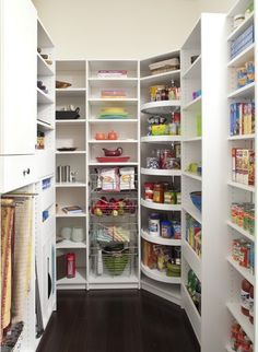 Pantry-Love the multi lazy-susans in the corner.