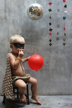 Great idea for a superhero party just write the age on the balloon..
