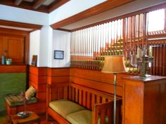 """Interior of Frank Lloyd Wright's 1892 George Blossom """"Bootleg"""" House. FLW often used wooden screens to accent his interior design. #chicagosavvytours #franklloydwright"""