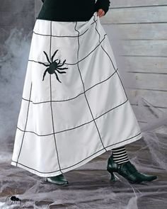 Another pinner said...I took this idea, got a white skirt at the Salvation Army and then used fabric paint to paint spider webs on it. People love it! I am so doing this!