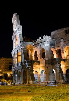 Colosseum iluminated at night, Rome, Italy