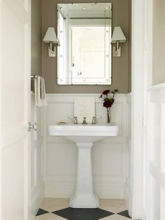Typically Narrow. Expand the look and feel of a narrow bath by replacing a space-hogging vanity with a pedestal or wall-mount sink. A quiet color scheme and eye-catching diamond pattern on the floor make a great background for the textured wall paneling in this pint-size bathroom.