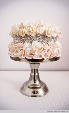 This glam cake is almost too gorgeous to eat! #weddingcakes