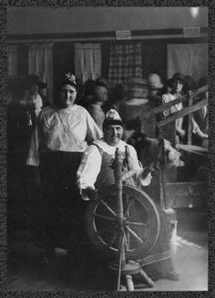 Doukhobor women with spinning wheel and loom.