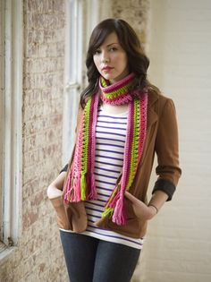 Taffy Pull Scarf  I dunno why, but I like it.  Stitch n' Bitch is probably my favorite supplier of patterns and tips. (Found at www.stitchnationy..., by Debbie Stoller).