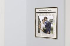 Create a unique frame from the newspaper headlines on the day of the #wedding. Use the KODAK Picture Kiosk to print a photo of the bride and groom from the wedding.