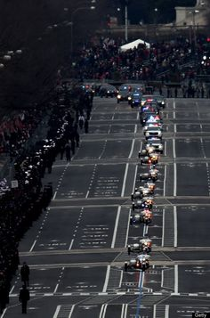 The presidential motorcade travels down Pennsylvania Ave. during the presidential inauguration January 21, 2013 in Washington, D.C. (Photo by John Moore/Getty Images)