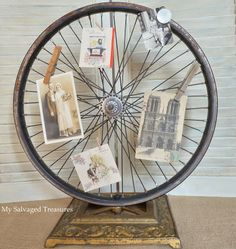 Bicycle wheel and floor lamp base picture/card holder.