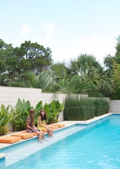 Love the conversation area with cushions to sit on while putting your feet in the pool