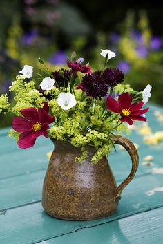 Set up something like this!  Rustic vase with flowers.