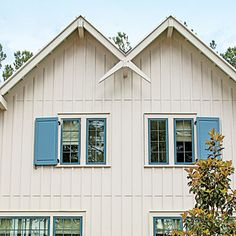 Exterior: The Double Gable | The exterior's razorsharp silhouette is highlighted by an X shape by extending and crossing the roof's rafter tails.