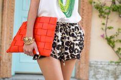 @stylebungalow pairs her orange TJMaxx clutch with  cheetah print TJMaxx shorts. #maxxinista
