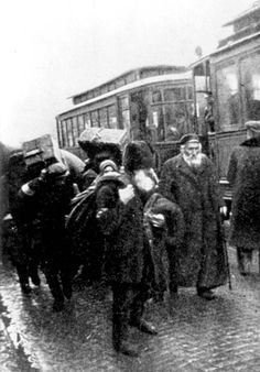 Warsaw, Poland, Jews who were deported to the ghetto alighting from train cars.