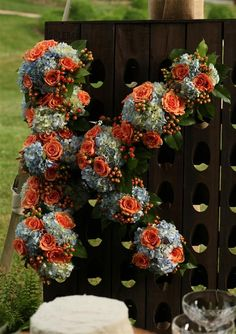 Use a riddling rack and flowers to create your initials at a wedding or event....