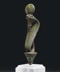 AN EGYPTIAN BRONZE URAEUS LATE PERIOD, DYNASTY XXI-XXX, 664-343 B.C.