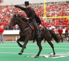Texas Tech Red Raiders - mascot The Masked Rider on his horse