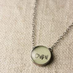 Capture a child's handwriting in a charm to wear around your neck.
