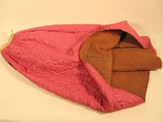 """Calamanco Quilted Petticoat  Object NamePetticoat  Object #1993.300.362  DescriptionBright pink, quilted, pettcoat lined with brown linsey/woolsey. Called a """"calamanco"""" petticoat.  Date1760-1800  SubjectsClothing & dress  Underwear  Women"""