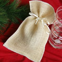 Natural Burlap Favor Pouches by Beau-coup.com.....perfect for our flower seed favors!! :]