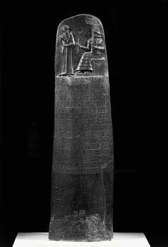 """The Code of Hammurabi, the Sixth Babylonian king (1792-1750 BCE), 282 laws. Hammurabi standing before the sun-god Shamash. Originally from Babylon, found at Susa, Iran. One of the oldest deciphered writings of significant length in the world.  The Code consists of 282 laws, with scaled punishments, adjusting """"an eye for an eye, a tooth for a tooth"""" (lex talionis) as graded depending on social status, of slave versus free man. Inscribed in the Akkadian language, using cuneiform script."""