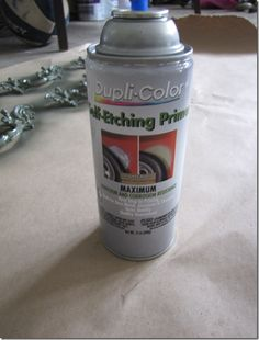 Use automotive self-etching primer for better adhesion when spray painting door knobs?  I'm going to try it out.