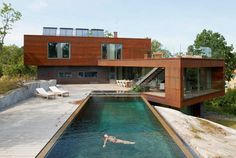 If there was a contest for coolest pool, then Villa Midgård by DAPstockholm would probably place in the top ten. This gorgeous home, located in Stockholm, was built to be virtually maintenance free on the exterior. They wanted it to feel solid and secluded, and yet allow the owner to feel close to nature.