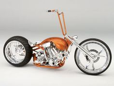 copper harley clone vtwin custom with single-sided rear axle and wide rear tire | by Matt Hotch (?)