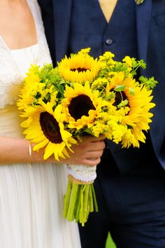 Sunflower Bouquet: On Style Me Pretty: http://www.StyleMePretty.com/tri-state-weddings/2014/03/14/natural-vineyard-wedding-with-sunflowers/ Ulysses Photography