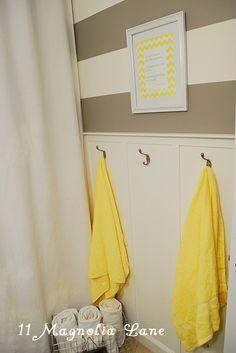 Wainscoting and stripes.. boys bath?