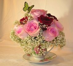 Flower arranging teacup wedding arrangement image