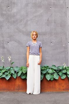 wide-legged trousers and a tee.
