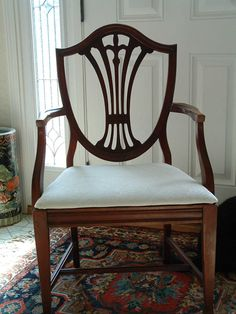 I am looking for two head chairs with arm rests from this collection.  Duncan Phyfe 1940s 9 piece Mahogany Dining Room set. 6 SHIELD BACK CHAIRS. 1 arm chair and 5 side chairs. Nice rich reddish color. New upholstery.