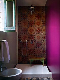 Bathroom: what a stunning feature these tiles make in the shower! Last week I met a supplier which does deal with reclaimed Spanish tiles....mmm I can see an idea taking shape in my head!