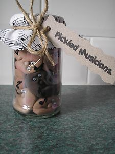 Pickled Musicians!!  individually hand crafted faces layered in musical notes with a musically themed fabric lid. Non edible