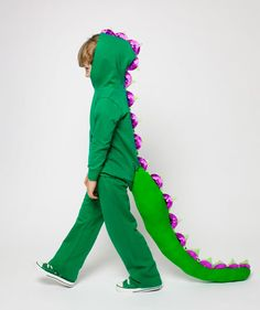 DIY Dragon Costume by realsimple: For this costume, start with sweatpants and a hooded sweatshirt and turn to a few household items­—cupcake liners, sponges—to pull this ferociously adorable look together. #DIY #Halloween #Kids #Costume