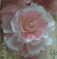 Love the flowers created by stamping on vellum