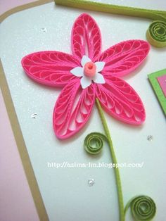 Quilling combing pink shades of flowers- love the white cut out and bead on top!  Clever!