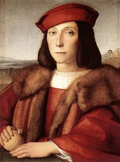 Young Man with an Apple - Raphael.  1505.  Oil on wood.  47 x 35 cm.  Galleria degli Uffizi, Florence, Italy.