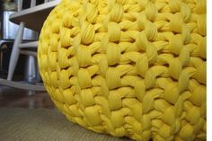 knit pouf out of plastic garbage bag strips and use it to cover old tires for outdoor table