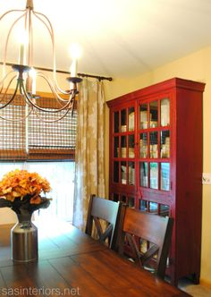 Dining Room by @Jenna_Burger, SAS Interiors. Red cabinet
