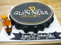 {Guiness Bottle Cap Cake}  Perfect cake for any beer-loving guy!  Our Cakes:  www.artisanbakeshop.com