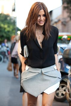 Great little office outfit - grey asymmetrical skirt paired with a black blouse. Add tights and ankle boots, and this outfit would totally rock.