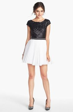 Sparkly bodice and a swingy,  pleated skirt.