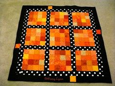 Halloween inspired quilt. So simple, but really cute with the fabric choices.  A great beginner quilt.  I would love to do this with purple & black