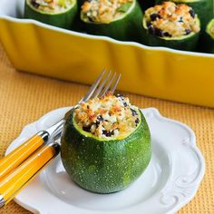 Recipe for Vegetarian Stuffed Zucchini with Brown Rice, Black Beans, Chiles, Cheddar, and Cotija Cheese; if you can't find the round zucchini just slice then lengthwise to make zucchini boats. [from KalynsKitchen.com] #GlutenFree #Meatless #Zucchini