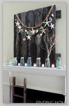 Summer Mantel - Love the seashell garland. ♥ Use some heavy rope, which has a nautical feel and drape it across the top. Glued or tie shells and mason jar lids to pieces of twine and tie them to the heavy rope instead of doing a traditional wreath.