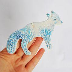 Really nice winter fox clay ornament